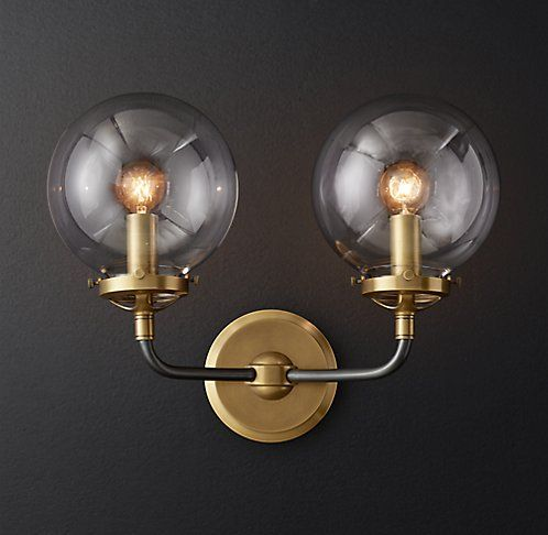 Rh moderns bistro globe clear glass double sconceinspired by industrialism our globe sconces lines and spheres are reminiscent of an urban subway map