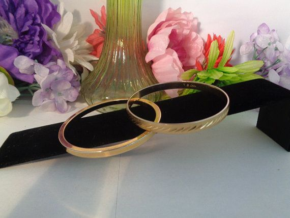 Vintage Monet Bangle Bracelets One in Silvertone and one in Goldtone. Wear them together or apart, Great additions to your collection.