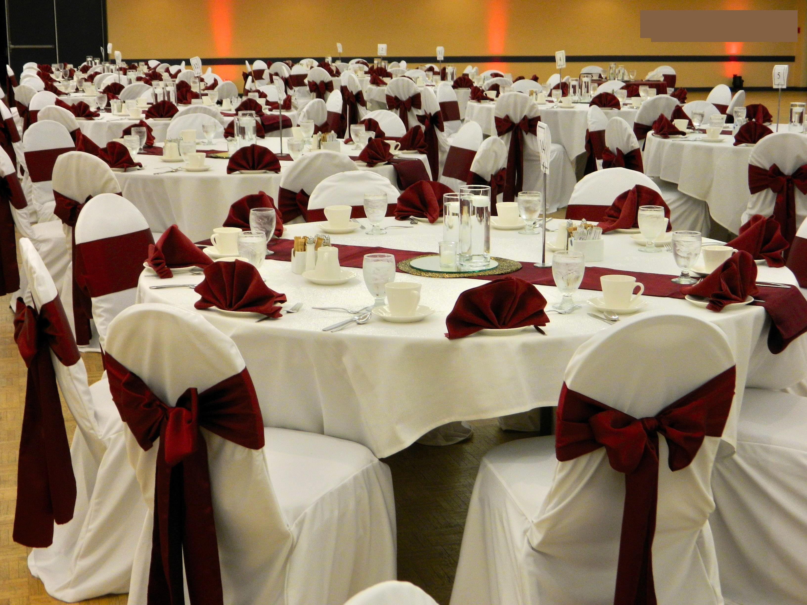 Ivory Linen Chair Covers With Burgundy Satin Sashes Tied In An