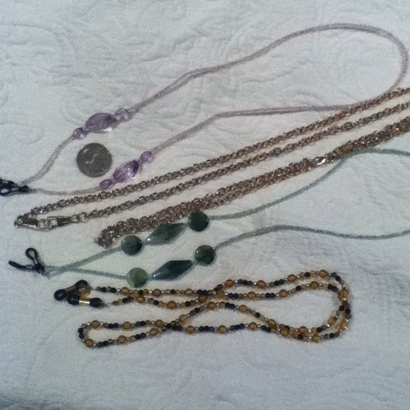4 assorted eyeglass holders 4 eyeglass holders. One very long gold tone chain, one green plastic beaded, one amythest plastic beaded and one black and topaz beaded. Other