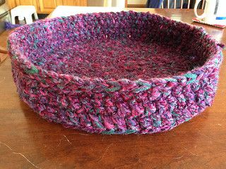 This pattern uses 4 strands of worsted or aran weight yarn held together. It is a lot faster to make the cat bed with double crochet instead of single crochet. However, this bed is not as firm as single crochet. The best trade-off might be to use single crochet on the sides and double crochet for the bottom.