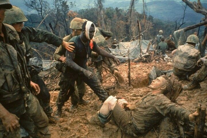 1966 | Wounded Marine Gunnery Sgt. Jeremiah Purdie (center) moves to try and comfort a stricken comrade after a fierce firefight during the Vietnam War. Photographed for an essay that ran in the October 28, 1966, issue of LIFE, this Larry Burrows picture —now regarded as one of the handful of utterly indispensable images from the war —did not appear in the magazine until February 1971.