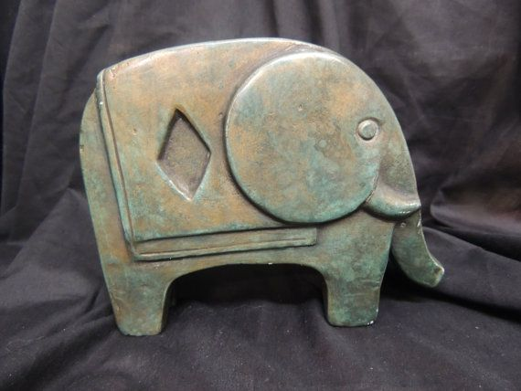 Here is an interesting vintage elephant statue appears to be ceramic or some other pottery