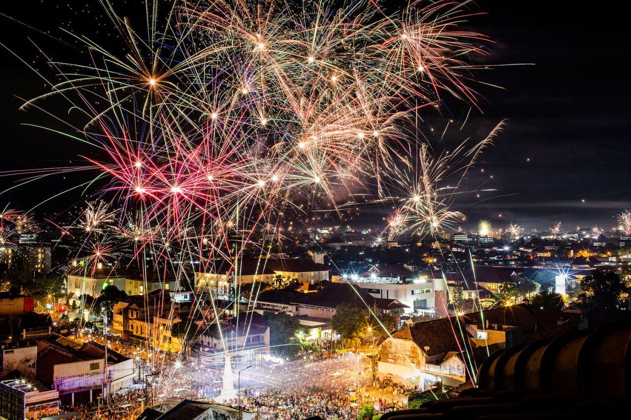 Fireworks illuminate the city's skyline during New Year's