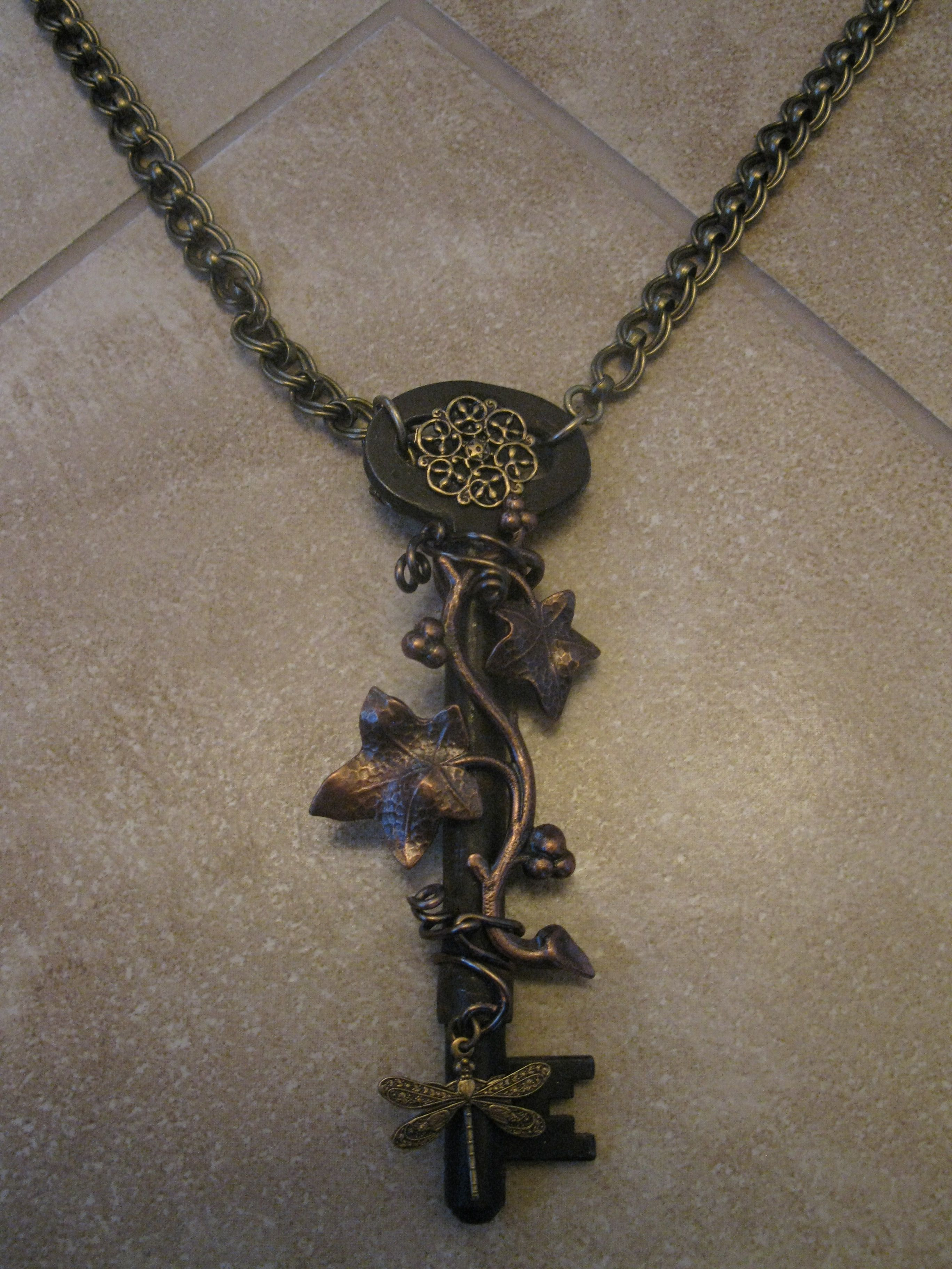 Antique key with brass and copper additions.  Note my little Dragonfly which I love to sneak in now and then!