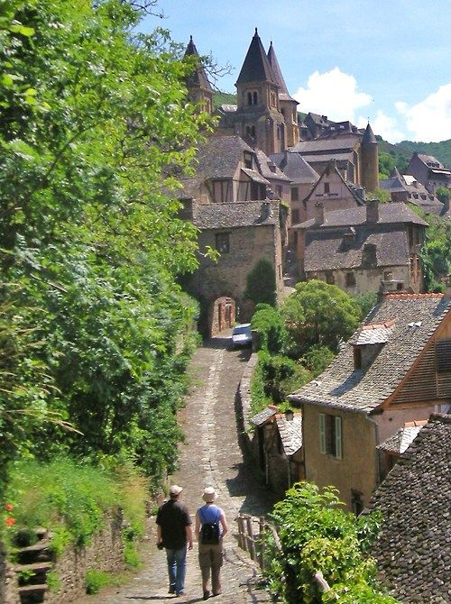 Conques, Midi Pyrenees, France. 30km east of Figeac, 35km north of Rodez. Listed as one of the most beautiful villages of France. Built on a hillside, it has classic narrow Medieval streets, so that large vehicles are prohibited and most visitors enter on foot.