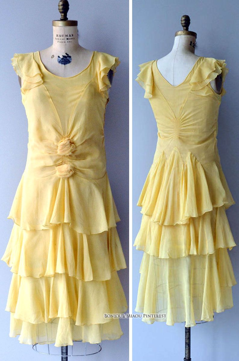 Evening dress ca. 1920s. Yellow silk chiffon with ruffled cap sleeves and rosettes at stomach. Skirt is 4 ruffled tiers; side snap closure. DearGolden/etsy