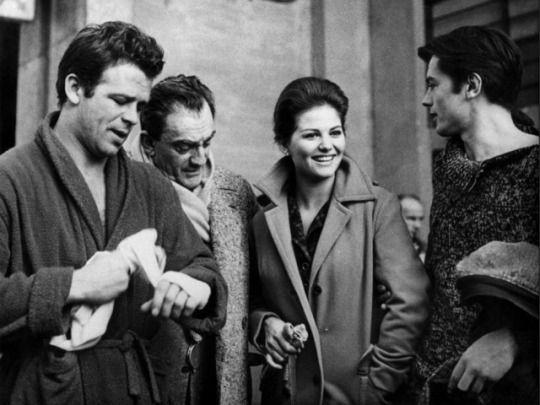 Renato Salvatori, Luchino Visconti, Claudia Cardinale and Alain Delon during the filming of Rocco e i suoi fratelli