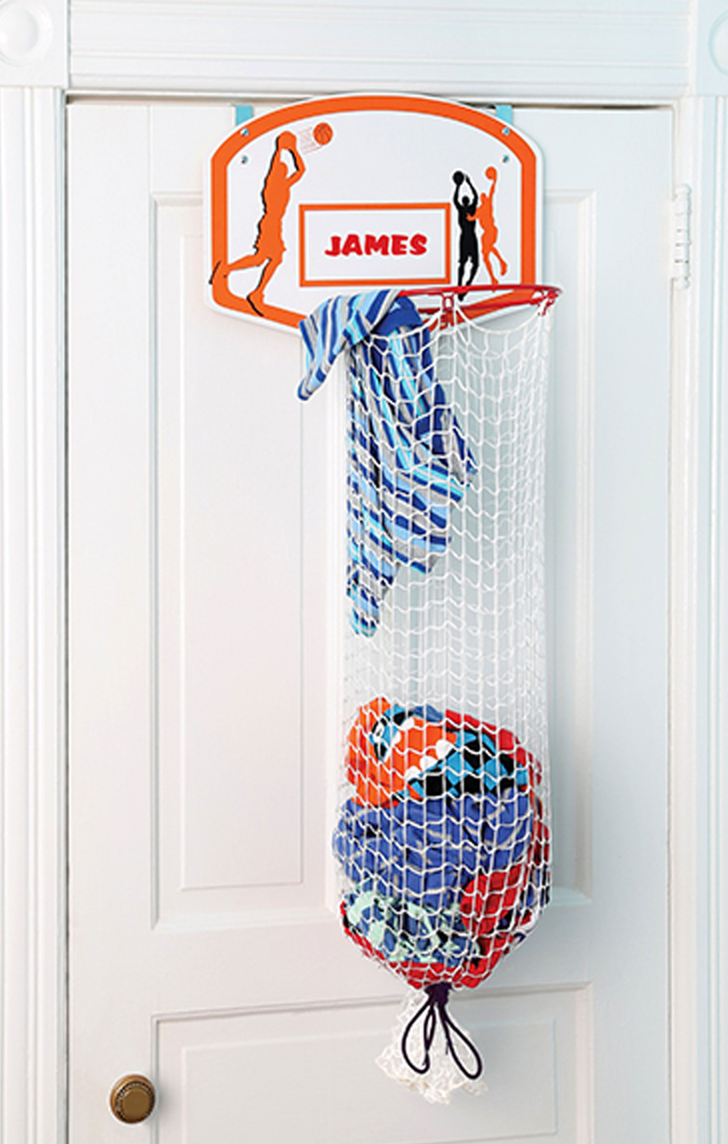 This basketball hoop clothes hamper lets kids pretend they for Basketball hoop for kids room