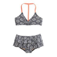 Made from our fast-drying, fade-resistant fabric (so she'll spend less time sitting around in a wet bathing suit), this cute two-piece is ready for cannonballs, boogie boarding and games of Marco Polo. <ul><li>Nylon/Lycra® spandex.</li><li>Lined.</li><li>Hand wash.</li><li>Import.</li><li>Online only.</li></ul>