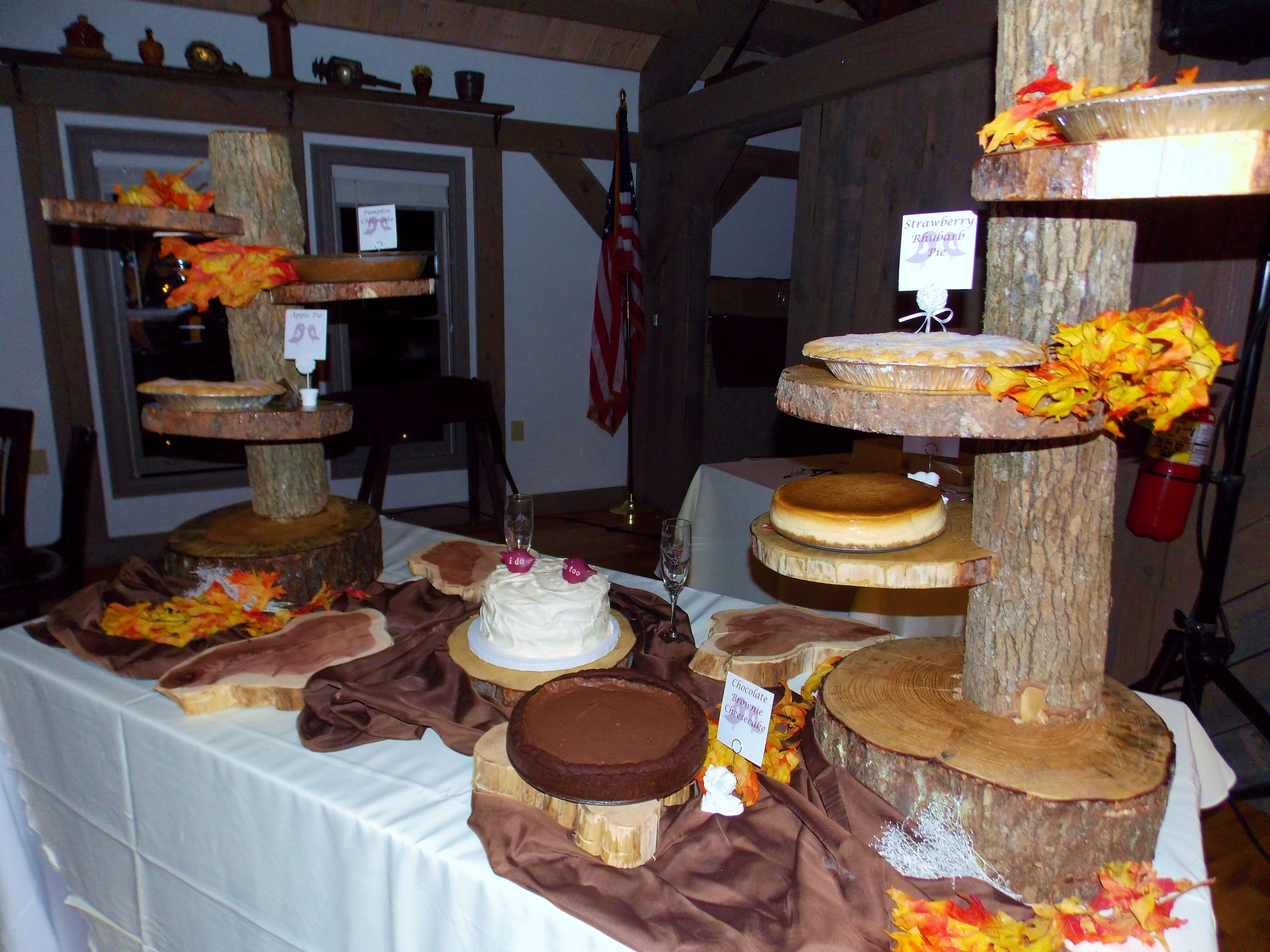 The trend has been getting away from the traditional wedding cake for a while. This is the first time I have seen pie and cheesecake. The groom made these great pie stands... Well done Andrew!