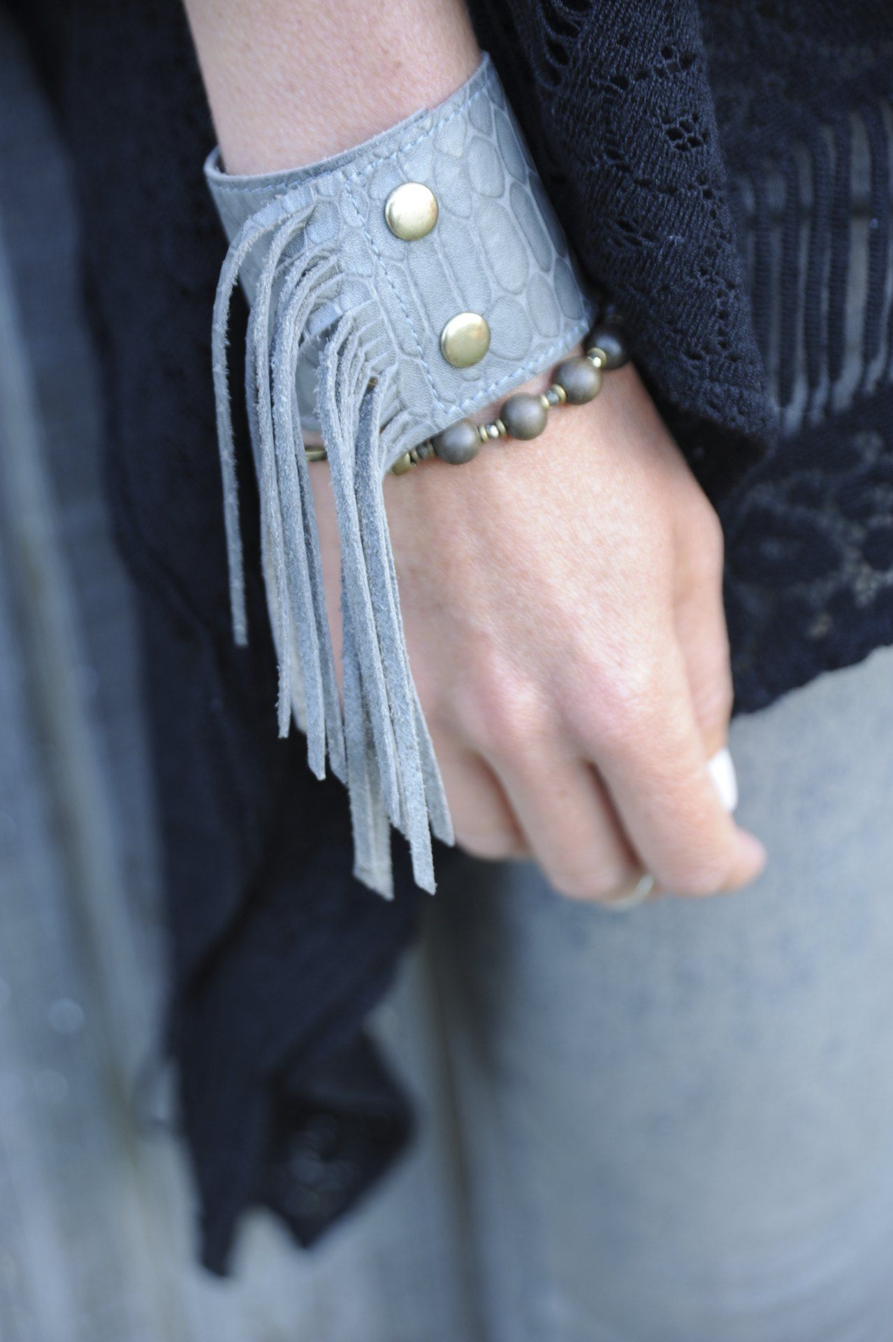 """Jessica models #heathergardner 2"""" Cali Fringe Cuff in Grey Snake Leather and our African grey and brass bead bracelet, showing how you can layer the cuffs with your stackable bracelets."""