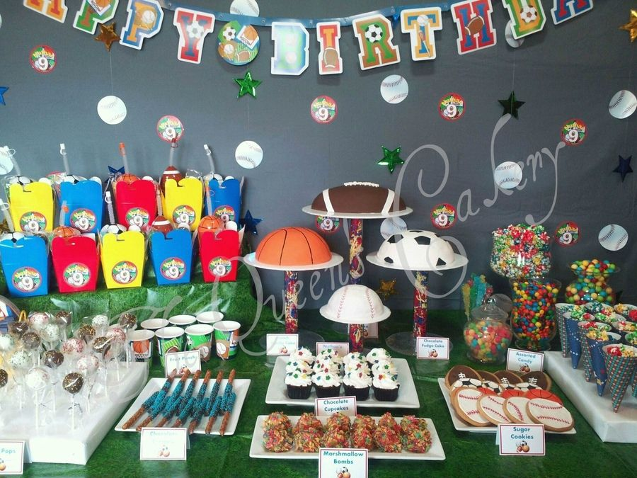 Sports Theme Dessert Table. Four Ball Cakes For Centerpiece. Custom Logo On  Backdrop And