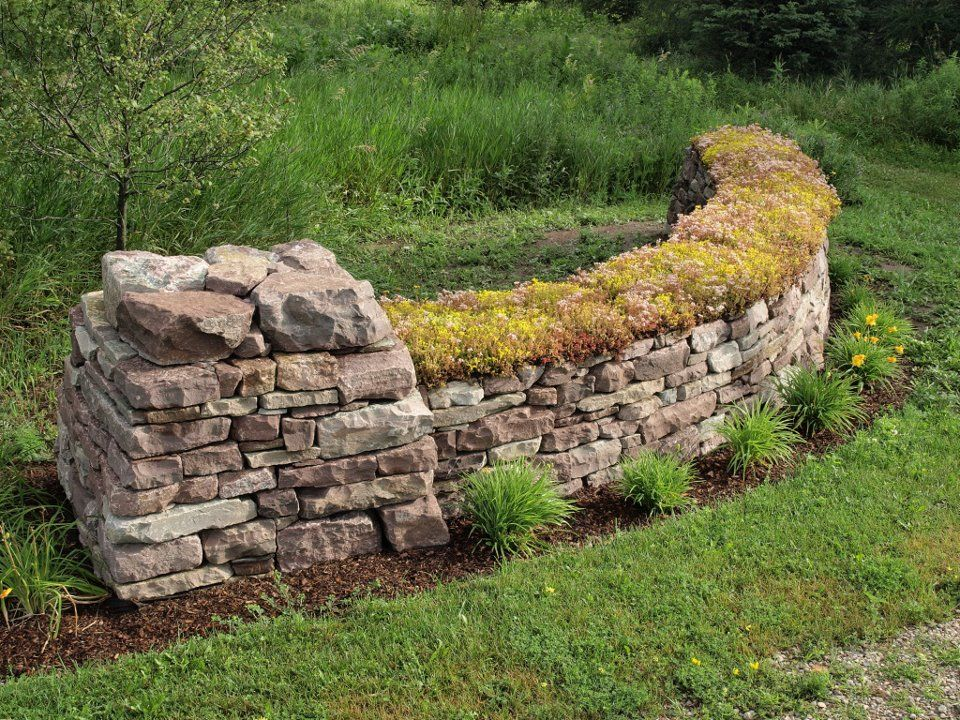 Dry stone wall with sedum on top, by Eric Landman http