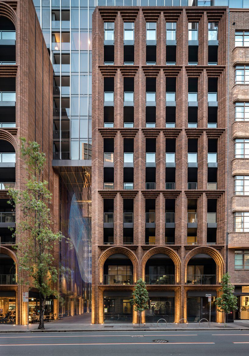 koichi takada architects uses over 300,000 bricks to create 'arc' in sydney