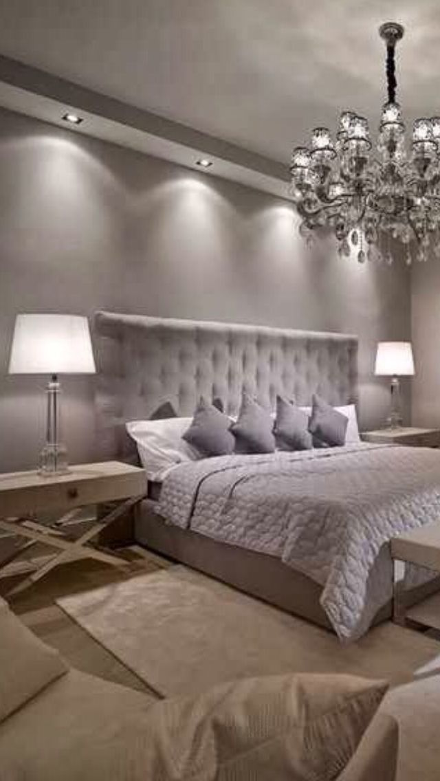 Luxury Bedroom design. Luxury chandelier. White table lamp