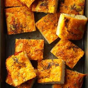 Poppy Seed Cheese Bread Recipe -THIS easy-to-make bread goes well with a salad luncheon or a casserole dinner. But I especially like to serve it with spaghetti and pasta dishes. The cheese topping is its crowning glory! -Elaine Mundt, Detroit, Michigan