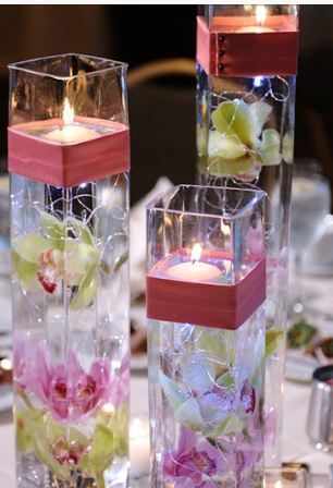 Square Vases With Submerged Flowers Floating Candles With A Coral