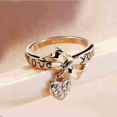 Bow ring with heart dangle Jewelry Pinterest