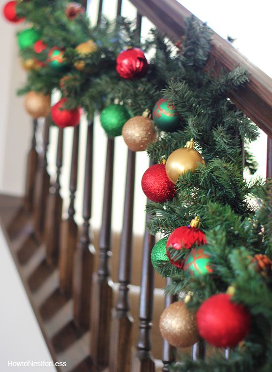9ft garlands from ace hardware for 8 each plus dollar general ornaments thats one super affordable staircase decoration