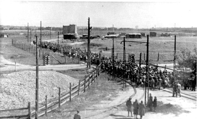 Lodz, Poland, Jews leaving the ghetto, most probably on their way to sanctioned work.