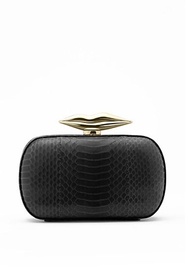 DVF   A playful take on a compact clutch, the Flirty features our signature lips hardware. http://on.dvf.com/1b8ZGai