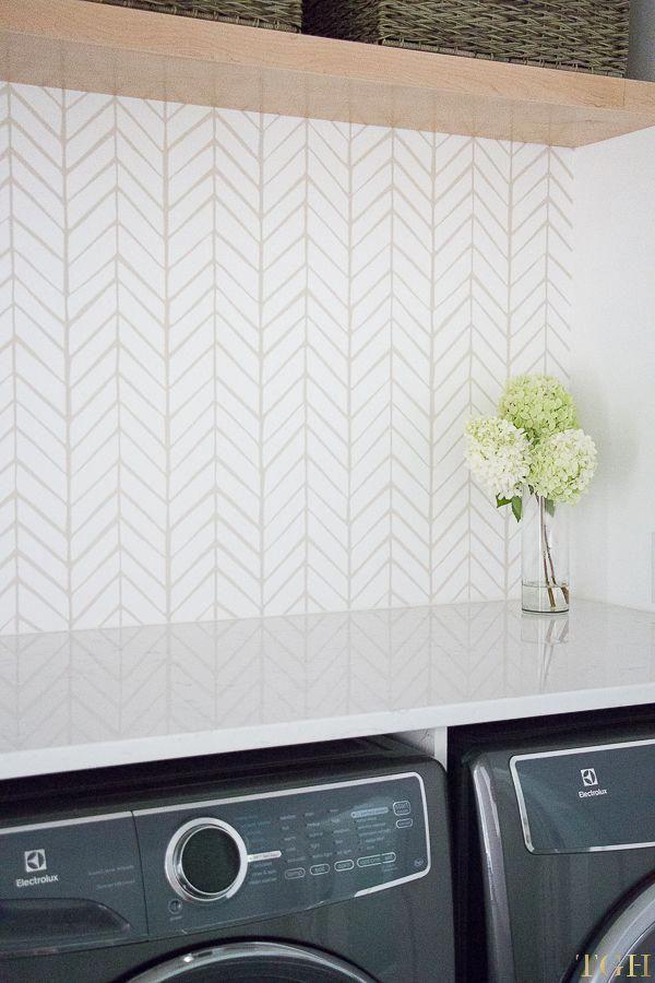 Modern laundry room remodel featuring herringbone ...
