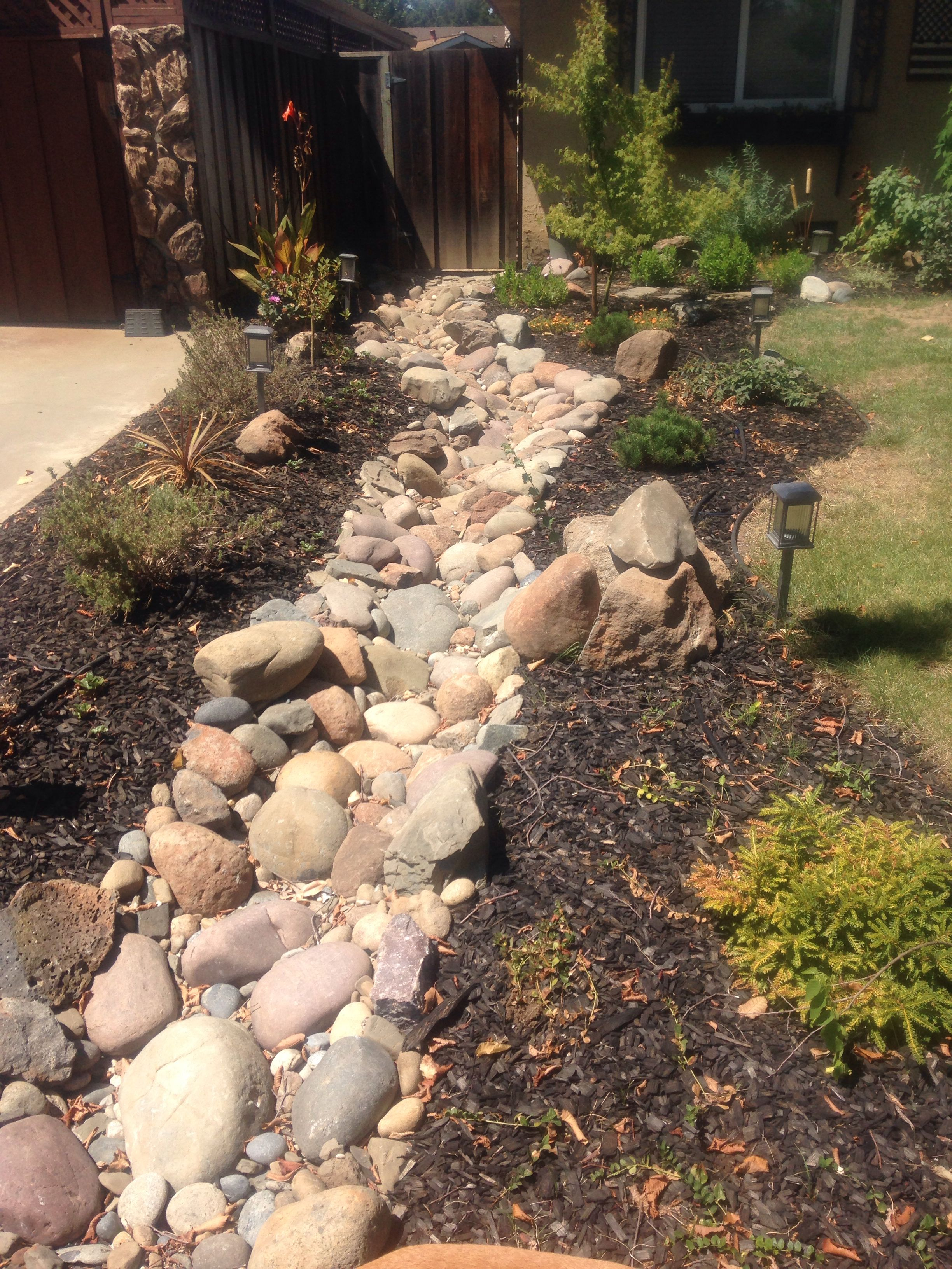 Rock rain gully incorporated into the landscaping | Small front gardens, Rock  garden landscaping, Easy landscaping