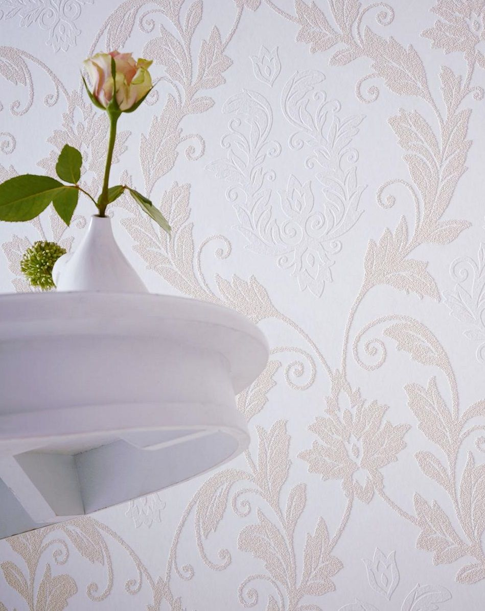 The demask patterning on this PAINTABLE WALLPAPER is made