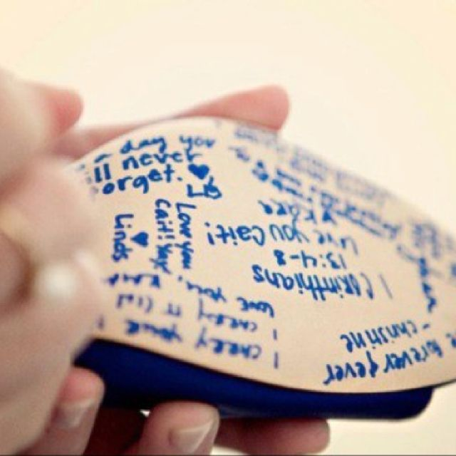 something blue - all the bridesmaids wrote a message to the bride on the bottom of her shoes so the most important people in her life could help her walk down the aisle. such a cute idea!