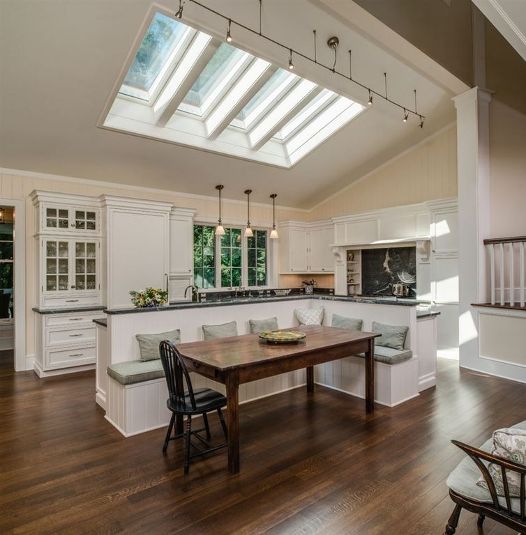 The Skylights Make This Kitchen Booth Seating Clean White Cabinets