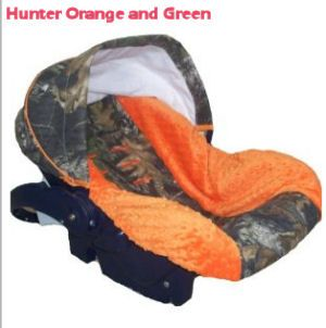 Hunter orange and Realtree Mossy Oak green camouflage baby car seat