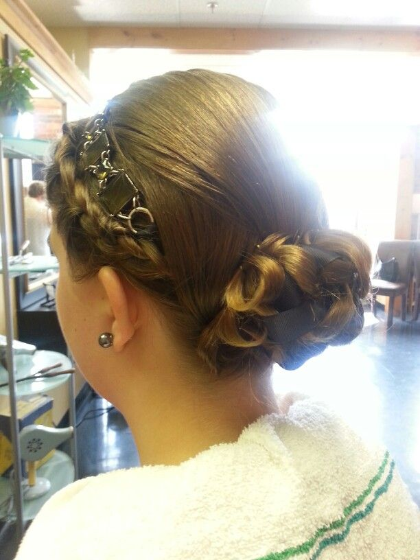 Curls in a low bun with ribbon weave