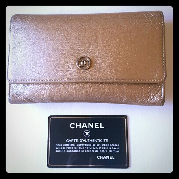 CHANEL Shimmering Oyster Wallet Beautiful authentic Chanel soft lambskin leather wallet. Pre- owned, all in working order. Authenticity card included with matching hologram sticker attached. No box or dust bag. Silver tone hardware. Fast ship!!! CHANEL Bags Wallets