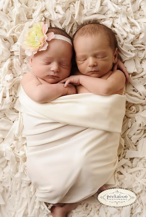 Twins wrapped up in the same blanket for a photo.... Deffinatly a very cute idea!