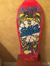 For $42.99 is an awesome RARE Santa Cruz Claus Grabke Exploding Clock 30 X 10 Skateboard Deck Reissue!