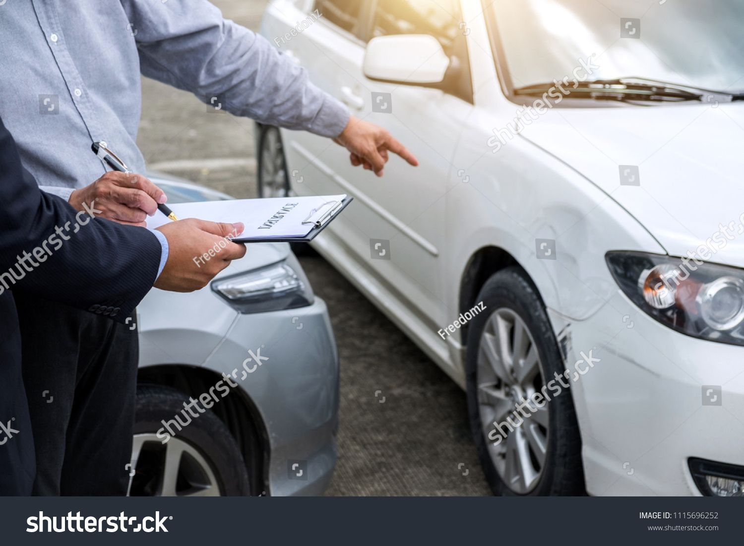 Insurance Agent Examine Damaged Car And Filing Report Claim Form