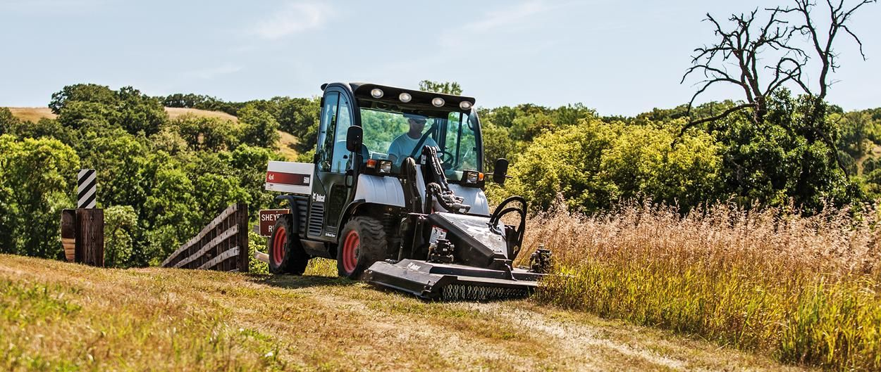 Bobcat Toolcat 5600 utility work machine and Brushcat rotary