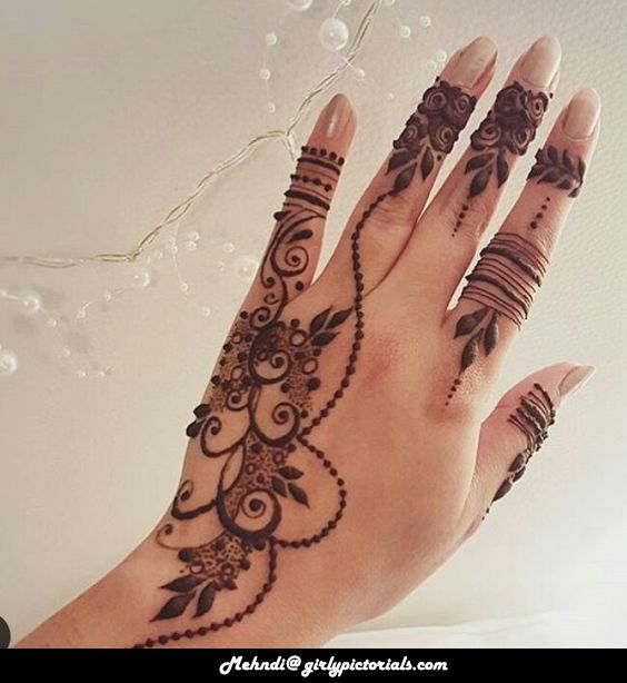 This Creative Mehndi Design gives you hands an awsome look. You can try this Mehndi Design on all of your special occasions. It's great!