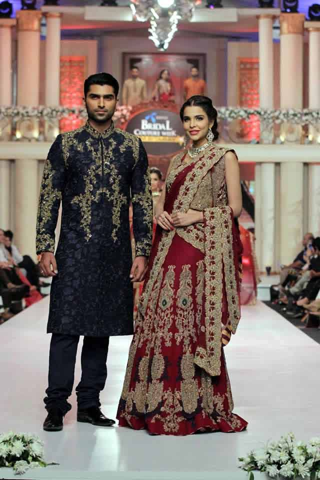 770002a3ca8 bridal in traditional maroon red lehnga choli with skin embroidery and groom  in dark blue embroidered kurta latest indian and pakistani wedding matching  ...