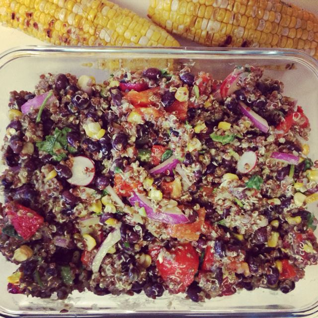 wfm inspired tex mex quinoa salad with cilantro lime jalapeño dressing: black beans, red quinoa, fire roasted corn and peppers on the grill, red onion, radish from our garden, pumpkin seeds, jalapeno, lots of cilantro...poured on the cilantro lime dressing and we had a yummy super!