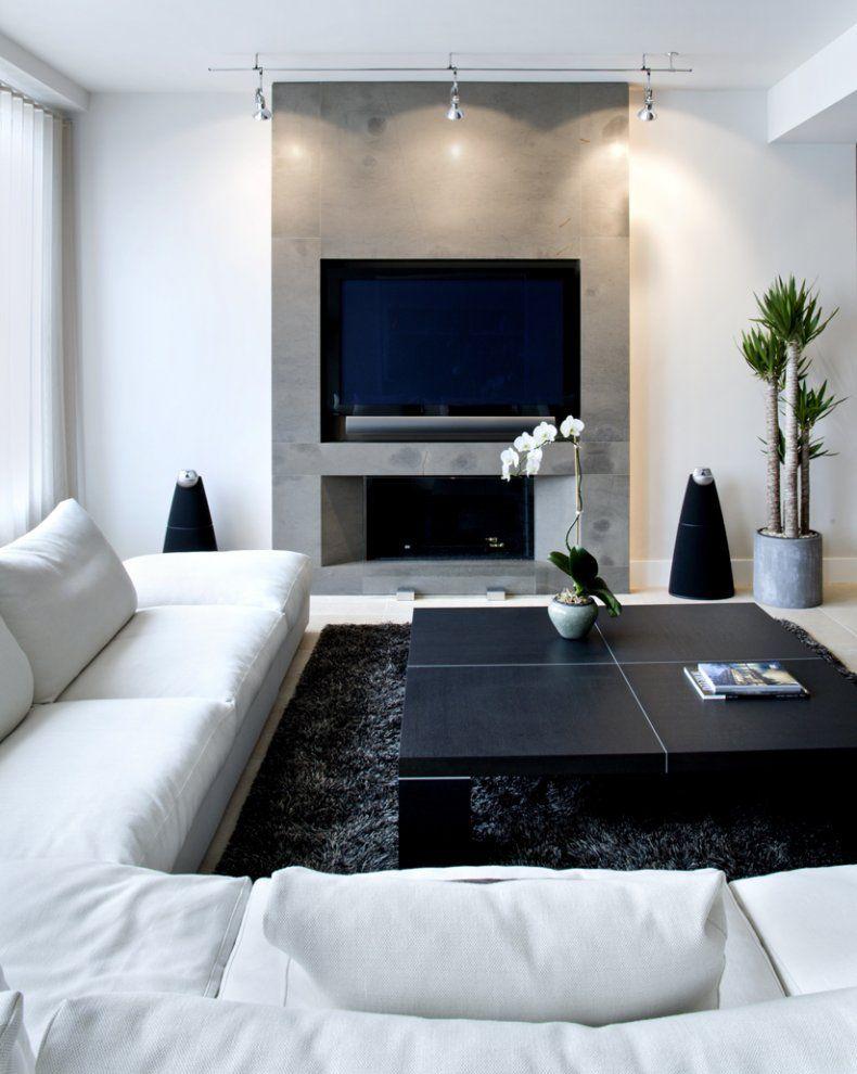 Chelsea Loft. Smaller, modern #fireplace under a mounted flat screen ...