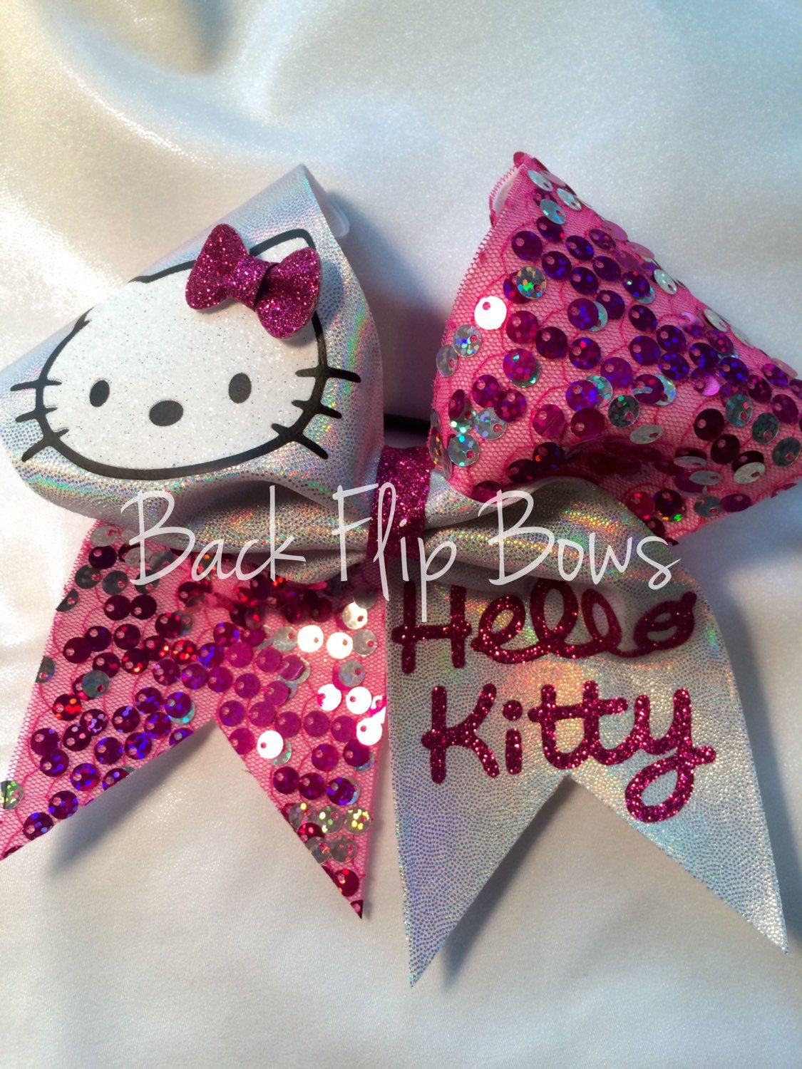 Hello Kitty Inspired cheer bow by BettysBackFlipBows on Etsy https://www.etsy.com/listing/214215589/hello-kitty-inspired-cheer-bow