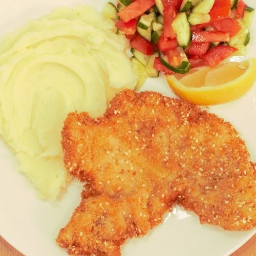 thin Israeli chicken schnitzels. Served with Israeli salad and mashed…