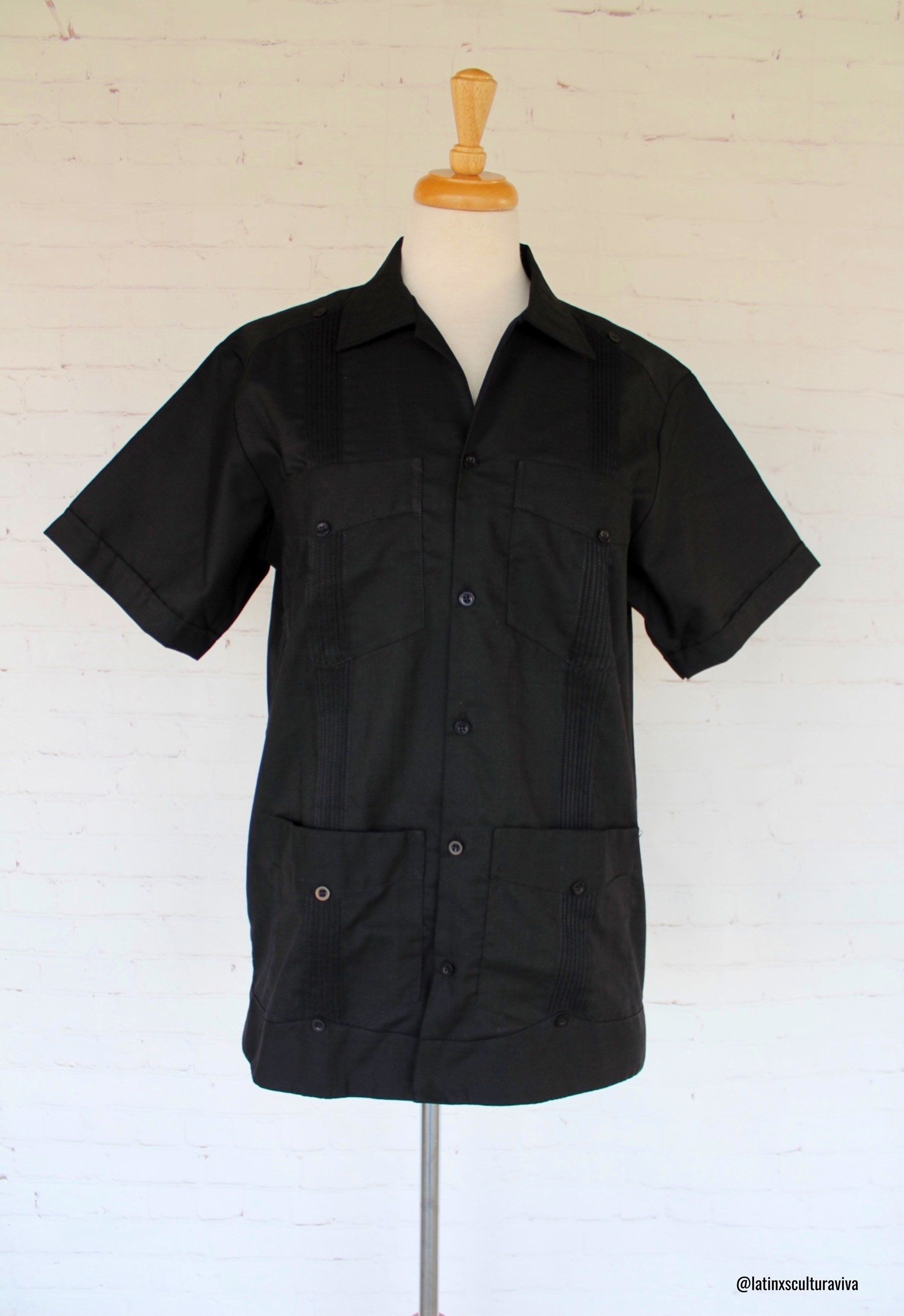 This black guayabera is an elegant garment, and very versatile. Guayabera can be wear on formal occasions like weddings, meetings, or in relaxed places such as fiestas and beaches, etc. A Mexican Guayabera is definitely a garment that you must-have for any occasion. This is a linen guayabera with 4 pockets on the front. Note: We recommend washing by hand. Each Guayabera shirt that we sell is authentic and made with love by artisans from Yucatan, Mexico.