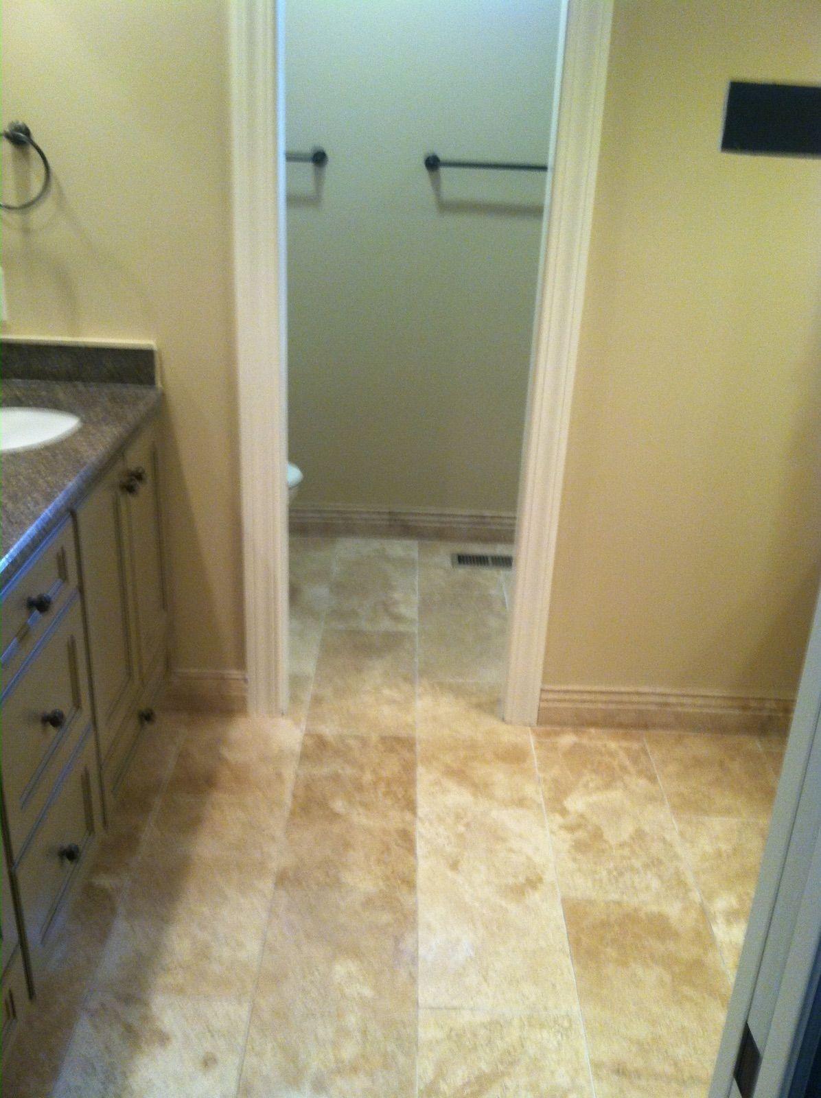 Travertine Neutral Tile Floor And Tile Baseboard For Bathroom
