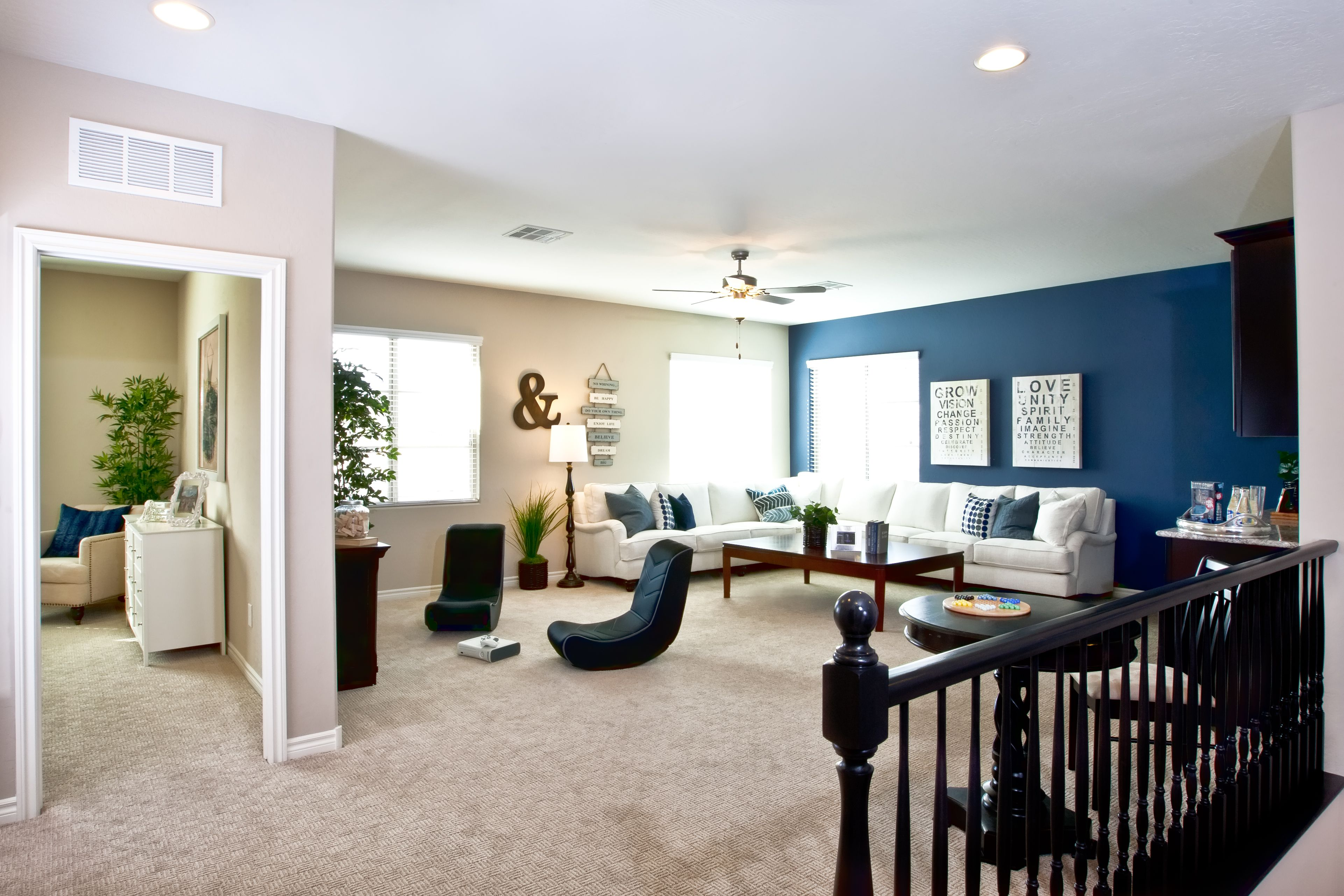 Planning on a nautical-themed family room? Sneak a peek at this spacious loft area from a model in our Catalina community for ideas!
