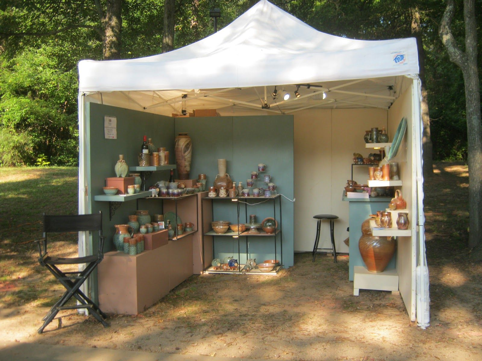 Jeff brown pottery the outdoor booth karanspotsandglass for How to set up a booth at a craft show