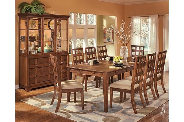 The Clifton Park Dining Room Extension Table From Ashley Furniture Homestore Afhs Com The Unique Contemporary Design And Soft Warm Finish Come Together To C