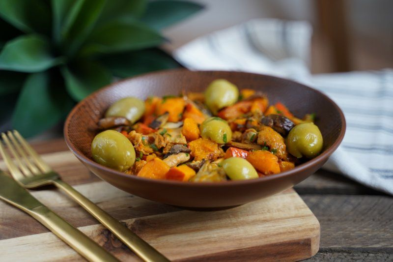 Photo of Sautéed pumpkin with chanterelles and Spanish olives